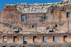 Colosseum, Rome. A fragment of Colosseum ruins in Rome Italy with blue sky on a summer day Stock Photos