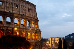 Colosseum, Rome Italy. The Colosseum, or the Coliseum, originally the Flavian Amphitheatre in Rome, Italy. the Arch of Constantine is in the background Stock Photography