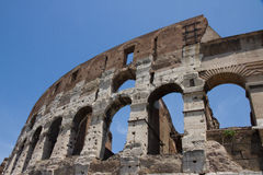 The Colosseum in Rome, Italy. With blue sky background Stock Images