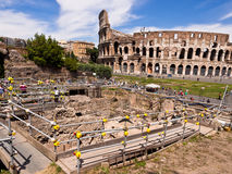 Colosseum Archaeology Dig in Rome, Italy. View of the Colosseum looking across an archaeological dig on the slopes of the Palatine Hill. Rome, Italy royalty free stock photos