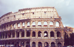 Colosseum Rome Italy. The Colosseum or Flavian Amphitheater (coliseum)was the first permanent amphitheater to be built in Rome.- scan picture stock photos