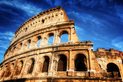 Colosseum in Rome, Italy. Amphitheatre over deep blue sky Stock Image