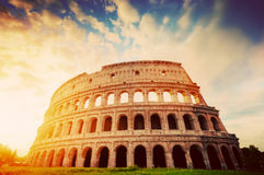 Colosseum in Rome, Italy. Amphitheatre in sunrise light. Vintage Stock Images