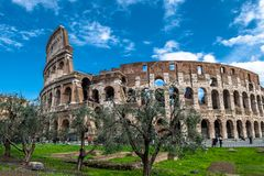 Colosseum in Rome in Italy. At sunny weather with tourists royalty free stock images