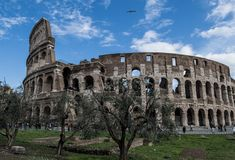Colosseum in Rome in Italy. At sunny weather with tourists stock images