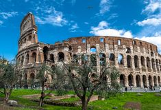 Colosseum in Rome in Italy. At sunny weather with tourists royalty free stock photography