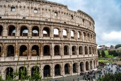 Colosseum in Rome in Italy. At sunny weather with tourists stock image