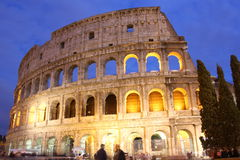 Colosseum (Rome, Italy) in the evening. The historic, ancient building of the Colosseum (Rome, Italy) in the evening. It was the largest amphitheatre of the Stock Photo