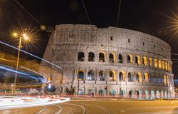 The Colosseum, Rome - Italy. The Colosseum at night with cars in motion blur, Rome - Italy Stock Photography