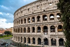 Colosseum in Rome in Italy. At sunny weather with tourists royalty free stock image