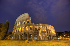 Colosseum in Rome, Italy during sunset Stock Images