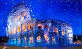 Colosseum of Rome - Might and Glory of Ancient Rome. A view of the city from a window from a high point during a rain Royalty Free Stock Photography