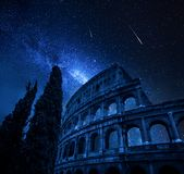 Colosseum in Rome with milky way and falling stars, Italy stock photography