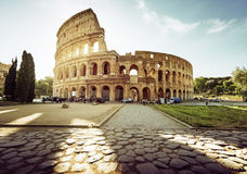 Colosseum in Rome and morning sun. Italy Royalty Free Stock Photos