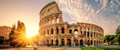 Colosseum in Rome and morning sun, Italy. Colosseum in Rome at sunrise, Italy, Europe royalty free stock photos
