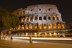 Colosseum in Rome, by night. Ancient building and modern light trail Royalty Free Stock Photography