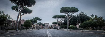 Colosseum Rome. Panoramic view of the `Via dei Fori Imperiali` with in background the Colosseum in Rome, Italy Stock Image