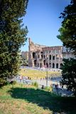 Colosseum rome seen from palantinehill, crowded with turists royalty free stock photos