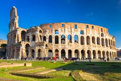The Colosseum in Rome at sunny day, Italy. Roman coliseum ancient landmark travel history architecture italian monument amphitheater skyline building old europe stock image