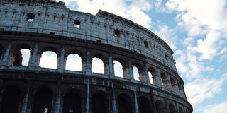 Colosseum in Rome on sunset - vintage style. Ancient amphitheater. Royalty Free Stock Photography