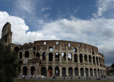 The Colosseum in Rome. Tourists flock to the iconic Rome landmark Stock Image