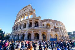 Colosseum Rome. Travel to Italy, Europe. Colosseum Rome. Ruins of the  ancient Roman amphitheatre. Travel to Italy, Europe. Crowd and queue. Sunny day and blue Royalty Free Stock Photos