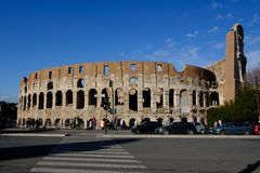 Colosseum Rome. Travel to Italy, Europe. Colosseum Rome. Ruins of the  ancient Roman amphitheatre. Travel to Italy, Europe. Crowd and queue. Sunny day and blue Stock Images