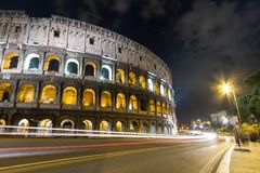 Colosseum Street. Traffic by the colosseum at night Stock Images