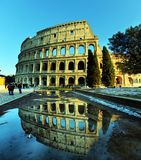 Colosseum on a sunny day with reflection in the water. In Rome.The main tourist attraction in Rome, ROME,ITALY - FEBRUARY 27,2018 royalty free stock images