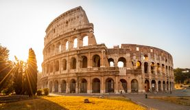 Colosseum at sunrise, Rome, Italy, Europe. Rome ancient arena of gladiator fights. Rome Colosseum is the best known landmark of Rome and Italy stock images