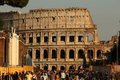 Colosseum at sunset. The roman monument Colosseo at the end of the day with a very busy street in foreground Royalty Free Stock Photo