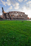 Colosseum at sunset in Rome, Italy. Ruins of antique Colosseum in sunise lights, Rome Italy Stock Photo