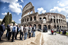 The Colosseum. A tourists group. Crowd of people. HDR stock images