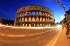 Colosseum and traffic light trails Stock Photography