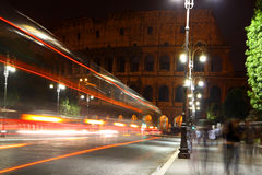 Colosseum and traffic lights Stock Photos