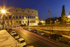 Colosseum and traffic lights at night Stock Photography