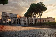 The Colosseum and the Triumphal Arch of Constantine in the sun, Rome, Italy royalty free stock photography