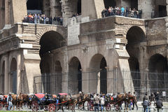 The Colosseum. Walking tour. Tourists and chariot Royalty Free Stock Photos