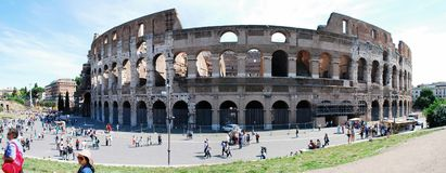 Colosseum was built in the first century in Rome city. ROME, ITALY - MAY 29: Colosseum was built in the first century AD by the Emperor Vespasian. Tourists in Royalty Free Stock Photography