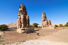 Colossi of Memnon. Giant statues near the Kings Valley, Luxor, Egypt Stock Photos