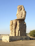 Colossi of Memnon in Egypt. Southern statue of the Colossi of Memnon, two huge ancient statues near Luxor in Egypt (Africa) at evening time Royalty Free Stock Photos