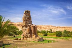 The Colossi of Memnon in Egypt. The Colossi of Memnon, two massive stone statues of Pharaoh Amenhotep III near Luxor, Egypt Stock Photo