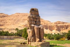 The Colossi of Memnon in Egypt. The Colossi of Memnon, two massive stone statues of Pharaoh Amenhotep III near Luxor, Egypt Royalty Free Stock Images