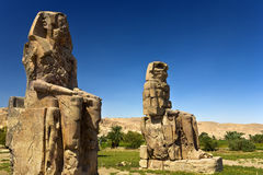 Colossi of Memnon. Egypt. Luxor. The Colossi of Memnon - two massive stone statues of Pharaoh Amenhotep III Royalty Free Stock Photography