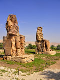Colossi of Memnon in Egypt. Colossi of Memnon are two gigantic stone statues depicting Pharaoh Amenhotep III Stock Images