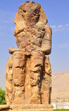 Colossi of Memnon in Egypt. Colossi of Memnon are two gigantic stone statues depicting Pharaoh Amenhotep III Stock Photos