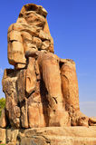 Colossi of Memnon in Egypt. Colossi of Memnon are two gigantic stone statues depicting Pharaoh Amenhotep III Royalty Free Stock Image