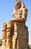 Colossi of Memnon in Egypt. Colossi of Memnon are two gigantic stone statues depicting Pharaoh Amenhotep III Stock Photo