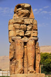 Colossi of Memnon in Egypt. Colossi of Memnon are two gigantic stone statues depicting Pharaoh Amenhotep III Stock Image