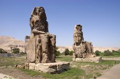 Colossi of Memnon, Egypt, Valley of Kings, Travel. Colossi of Memnon statues, all that remains of a huge temple complex in ancient Egypt. The site is not far Royalty Free Stock Images